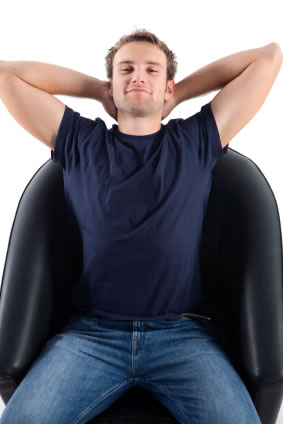 Man relaxing on leather chair